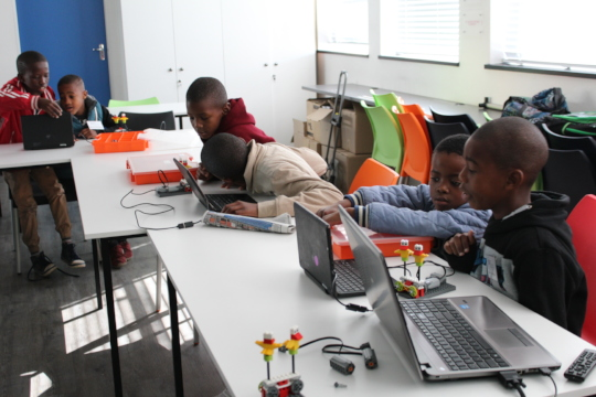 Children busy building and programming robots