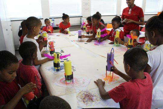 Children drawing with the art-bots they decorated