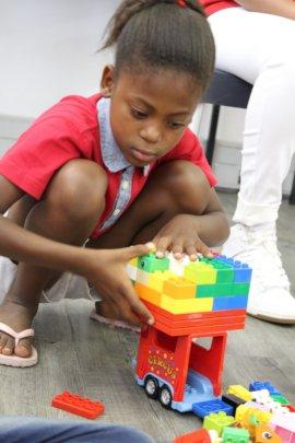 Tamia building with Lego Duplo
