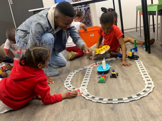 Sisonke, a facilitator, working with the children
