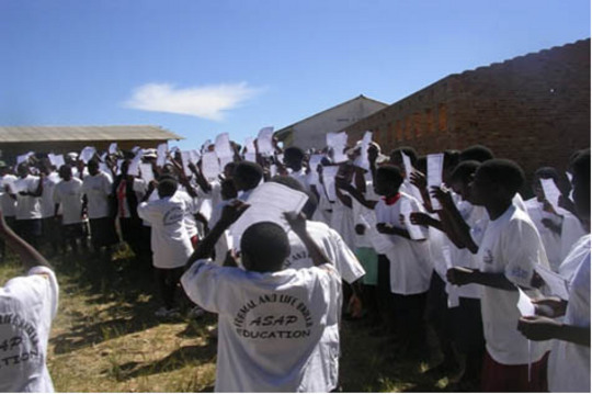 Children celebrate graduation at a field day in Mutasa District