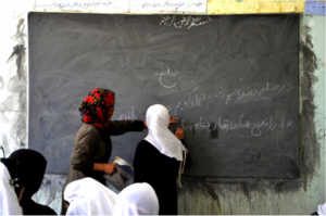 Students at chalkboard (Ayni)