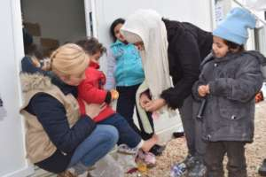Providing winter clothing to refugees in Serbia