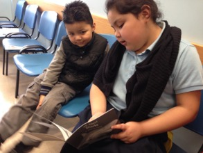 Allison reads to her brother Deric