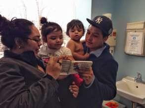 Ana, Roxi, Adrian, and Adrian Sr. read together