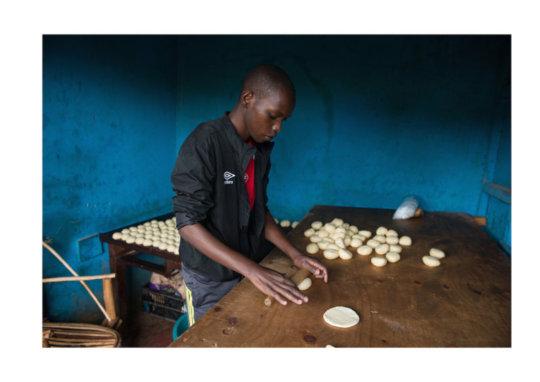 Bizimana rolling mandazi dough