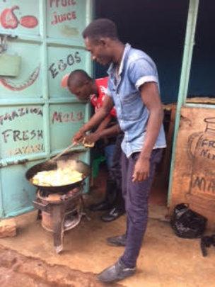 Bizimana and Otto cooking mandazi