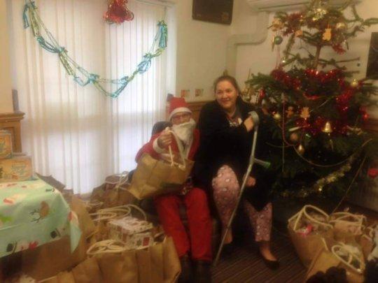 Santa sharing the donated Christmas presents