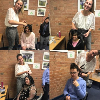 The fashion group having their hair done by Jenni.