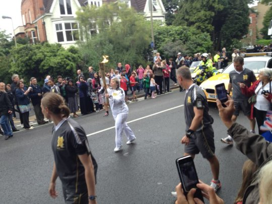 Maria carries the Olympic Torch