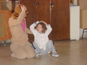 Mother and child playing in a workshop