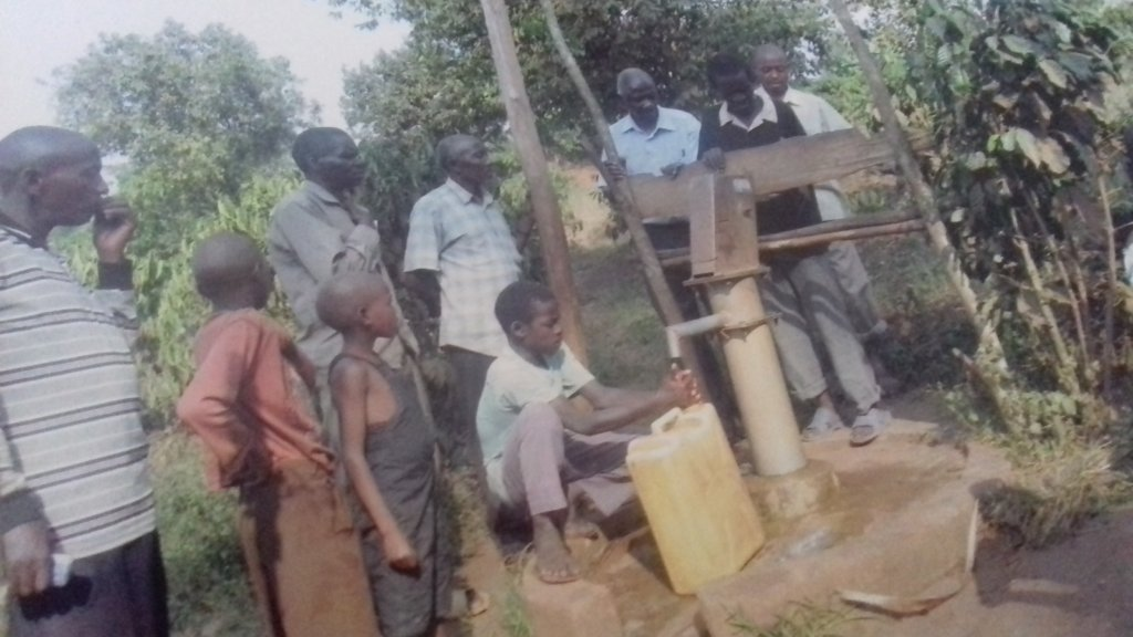 2 Photo Collecting water from the new Borehole