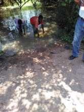 Namusisi's children collecting water before boreho