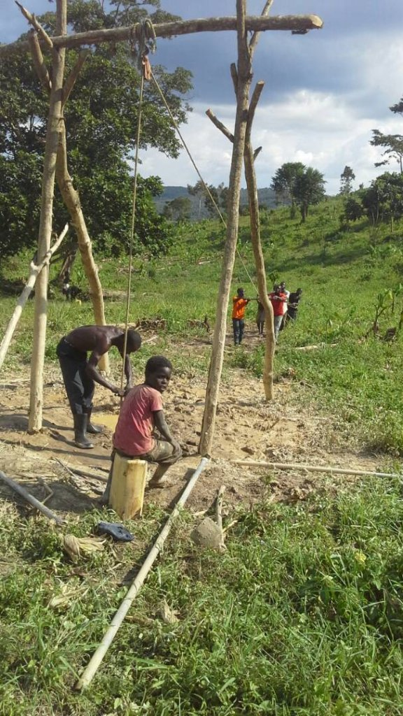 Community members participating in construction of