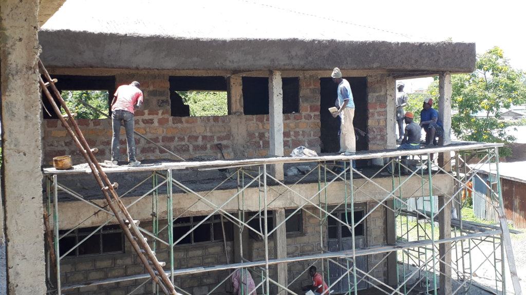 The site workers doing final exterior work