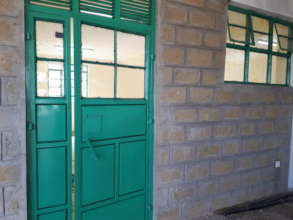 Classroom doors painted and window glasses fitted