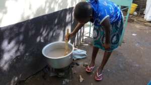 Beneficiary preparing a meal at the GEC
