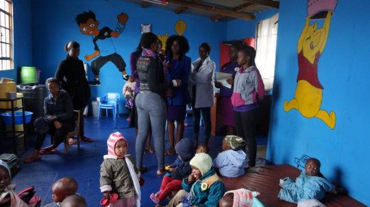 Girls Steering Committee members inside Childcare