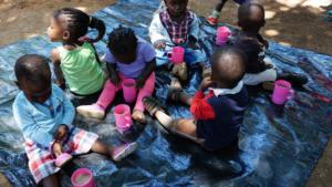 NIGEE beneficiaries' children enjoying Porridge