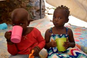 Kids enjoying a cup of 10'Oclock porridge at GEC