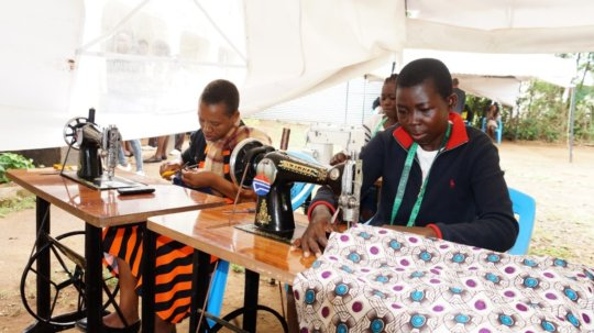 Girls doing their dressmaking practical session