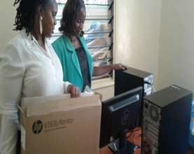 Staff receiving computers at the GEC