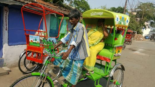 Salma's parents take delivery of a new rickshaw