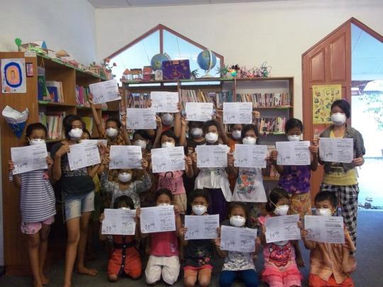 Children receiving information in YUM's library