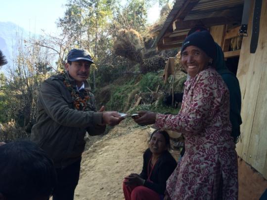 Village woman receiving stipend to buy door