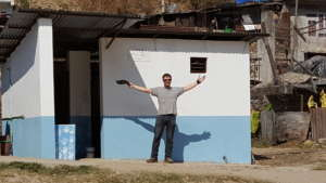 James in front of the completed toilets