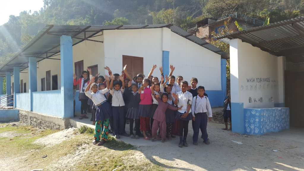The kids show off their new classrooms and toilets