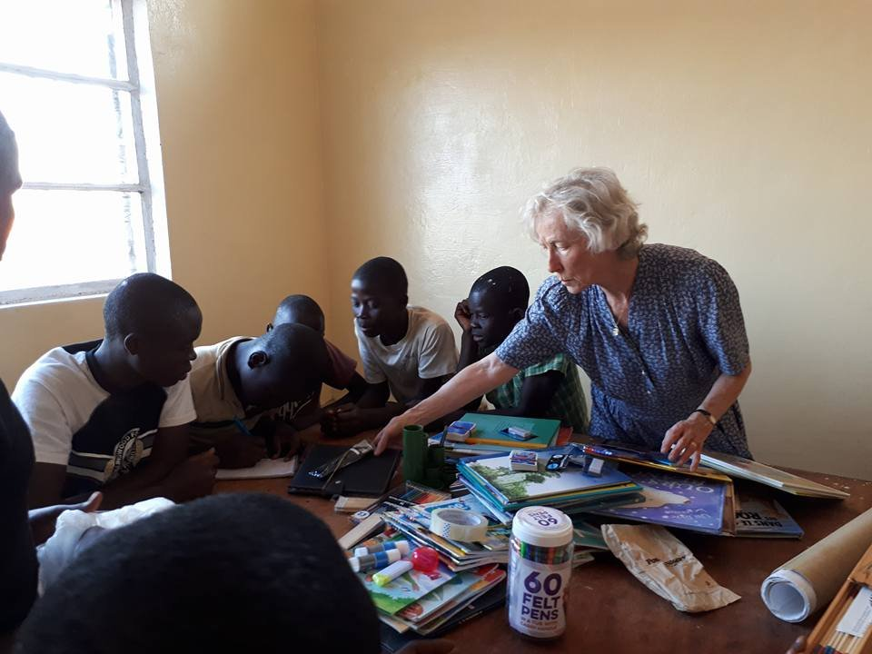Marguerite teaching dominoes to the children