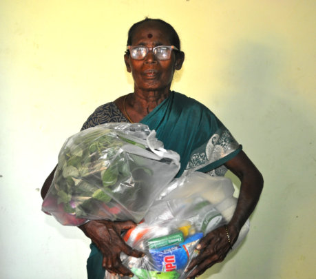 Elder women receiving food groceries