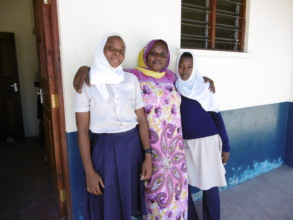 Mdm. T, Headteacher with two pupils
