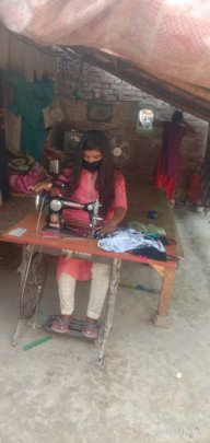 Girl Icon Jyoti stitching masks for her community