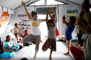 Women and girls doing yoga