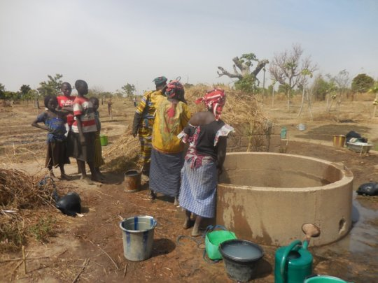 Women getting water from well