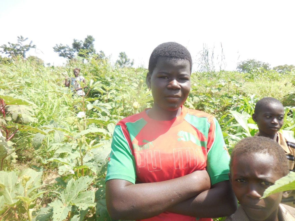 Natalie, a student helping grandmother to harvest