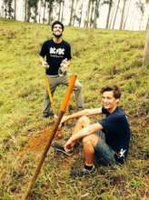 Gui and Tom preparing the land for the seedlings