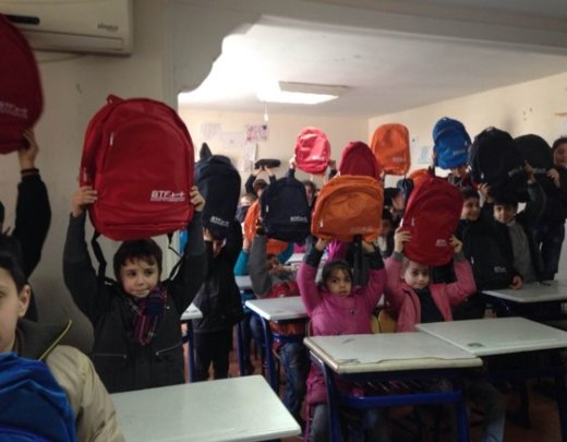 Syrian Refugee Children with Their New SchoolBags