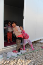 Happy children in new containers