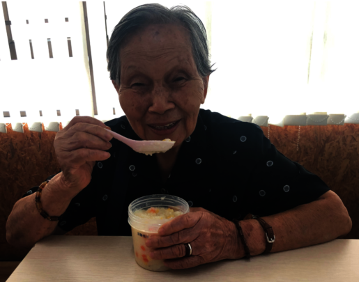 Grandma Kam trying out our new cook-chill congee!