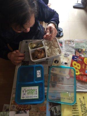 Grandma Ng enjoying her delivered hot meal box