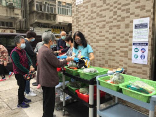 Distributing weekly food packs to elderly