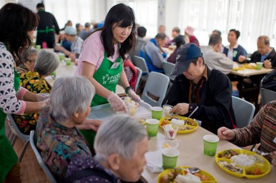 Volunteers serving elderly at the community centre