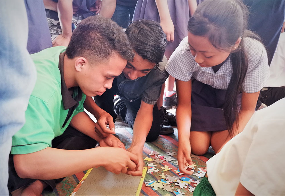 Students competing in puzzle competition
