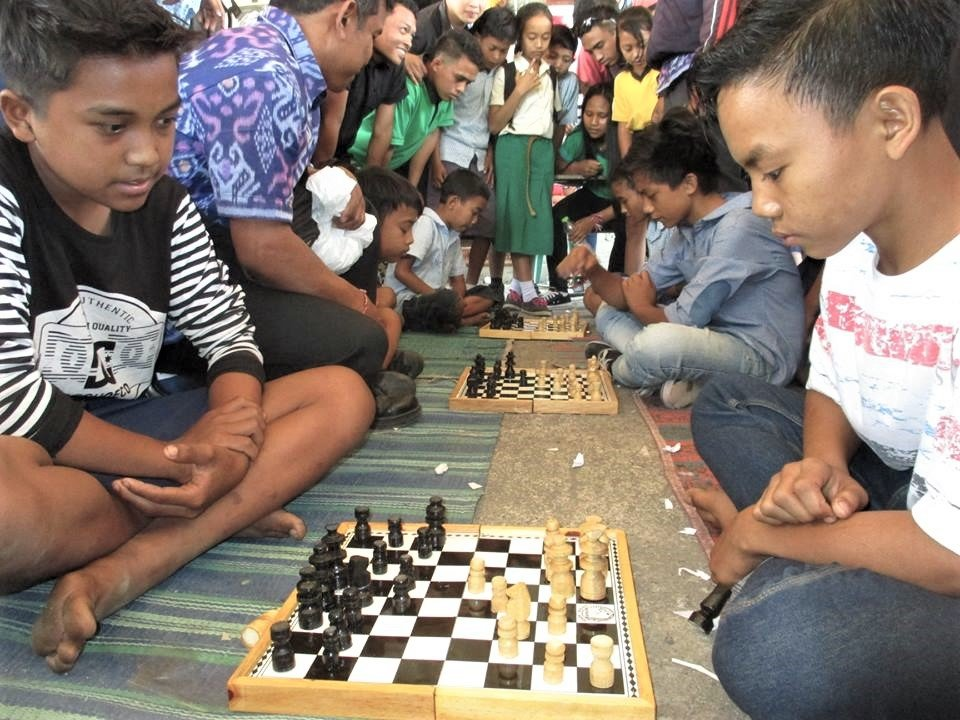 Students concentrating in chess competition