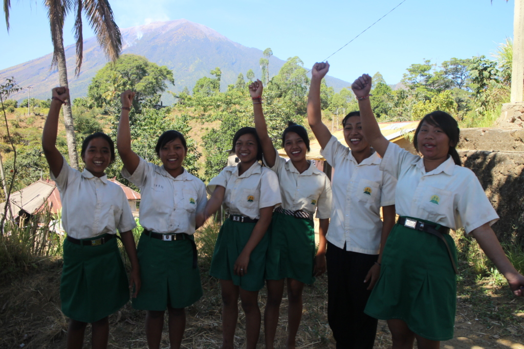 Jatituhu student with Mt Agung behind them