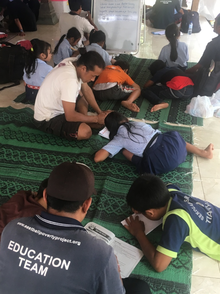 Students learning at evacuation camp