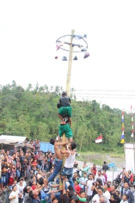 """""""Panjat Pinang"""" climb up a slippery pole"""